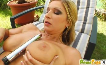 Angelina oils up and plays with her pussy